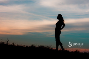 silhouette girl on hill