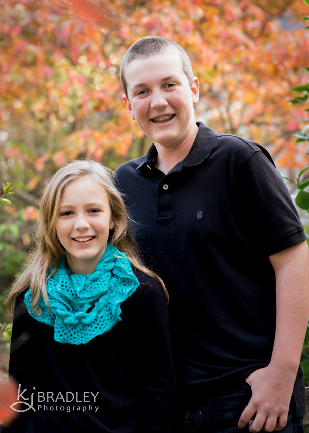 brother_sister_fall_leaves_portrait
